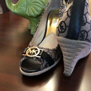 Ladies Michael Kors logo wedged shoe.  Size, 8